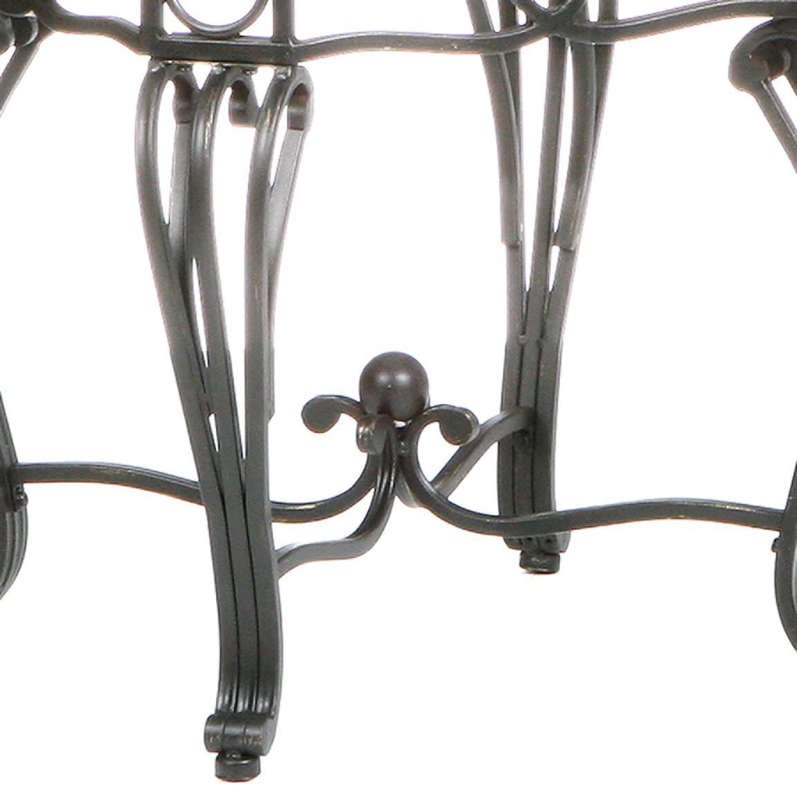 The metal legs are hand crafted with delicate curves and symmetrical details from top to bottom.
