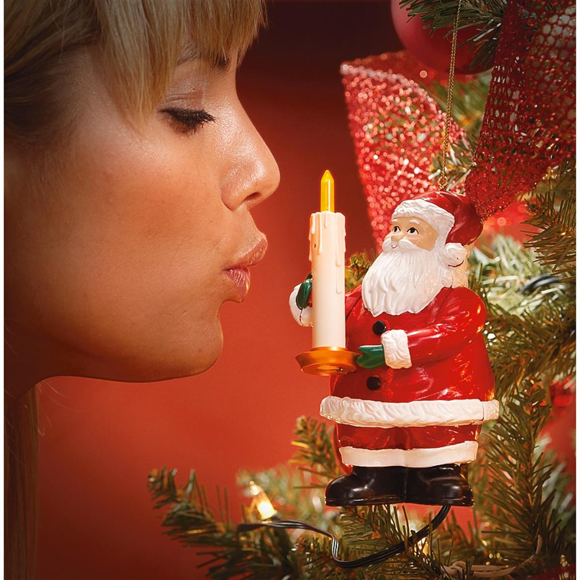 Good Night Lights® Santa Switch; Quick blow on candle, tree lights go out.  Blow again and they go on.