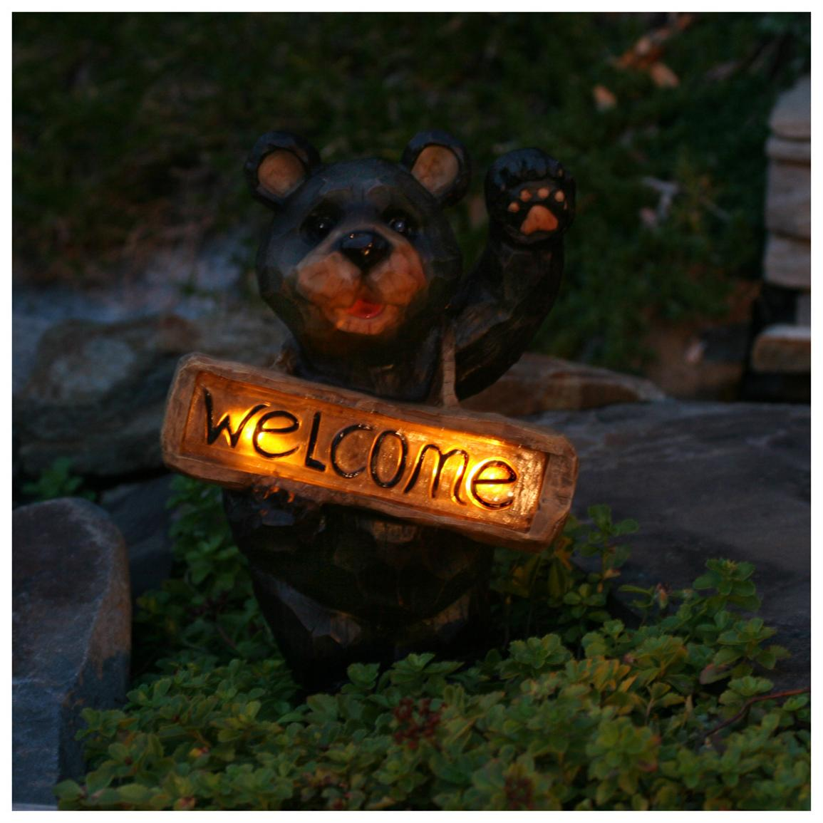 "2 gentle amber LEDs illuminate the ""welcome"" when the sun goes down"