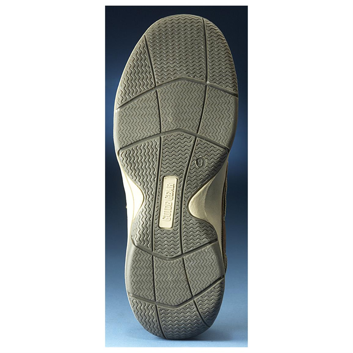Siped outsole grips wet surfaces