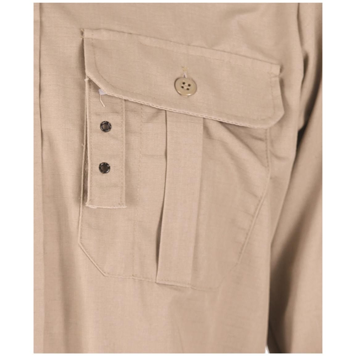 Two box-pleated chest pockets with button flaps