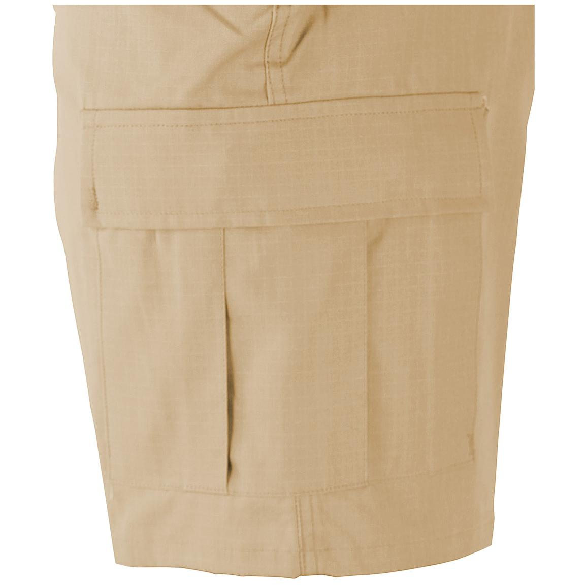 Two cargo pockets with button flaps and drainage holes