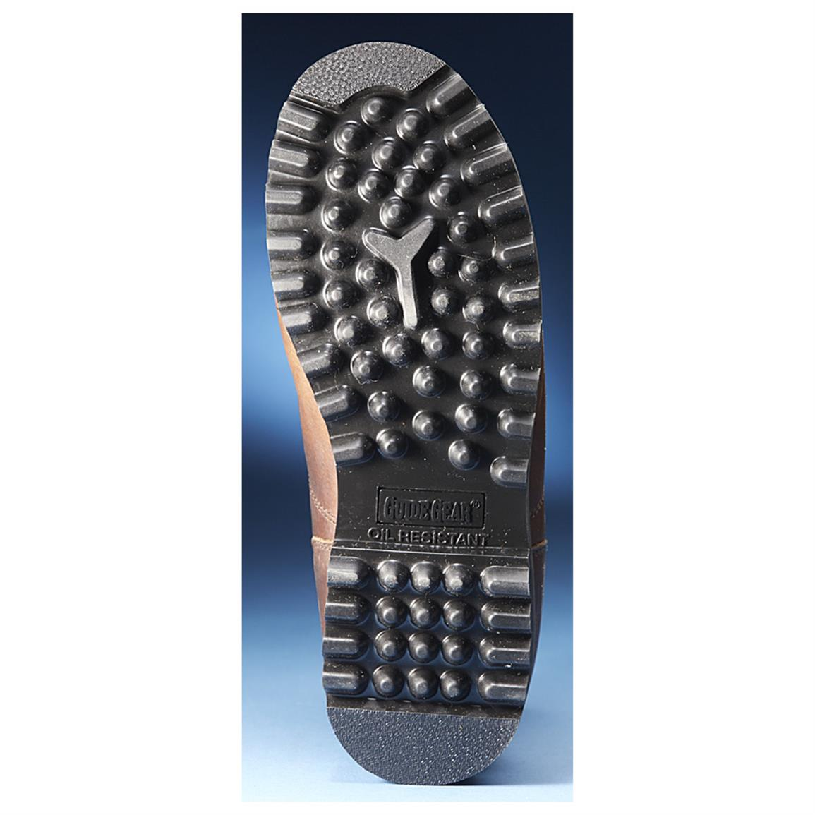 Deep-lug oil-resistant rubber outsoles for solid traction