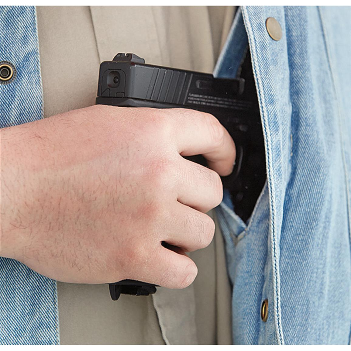 Elastic gun pockets hold handgun up for easy access