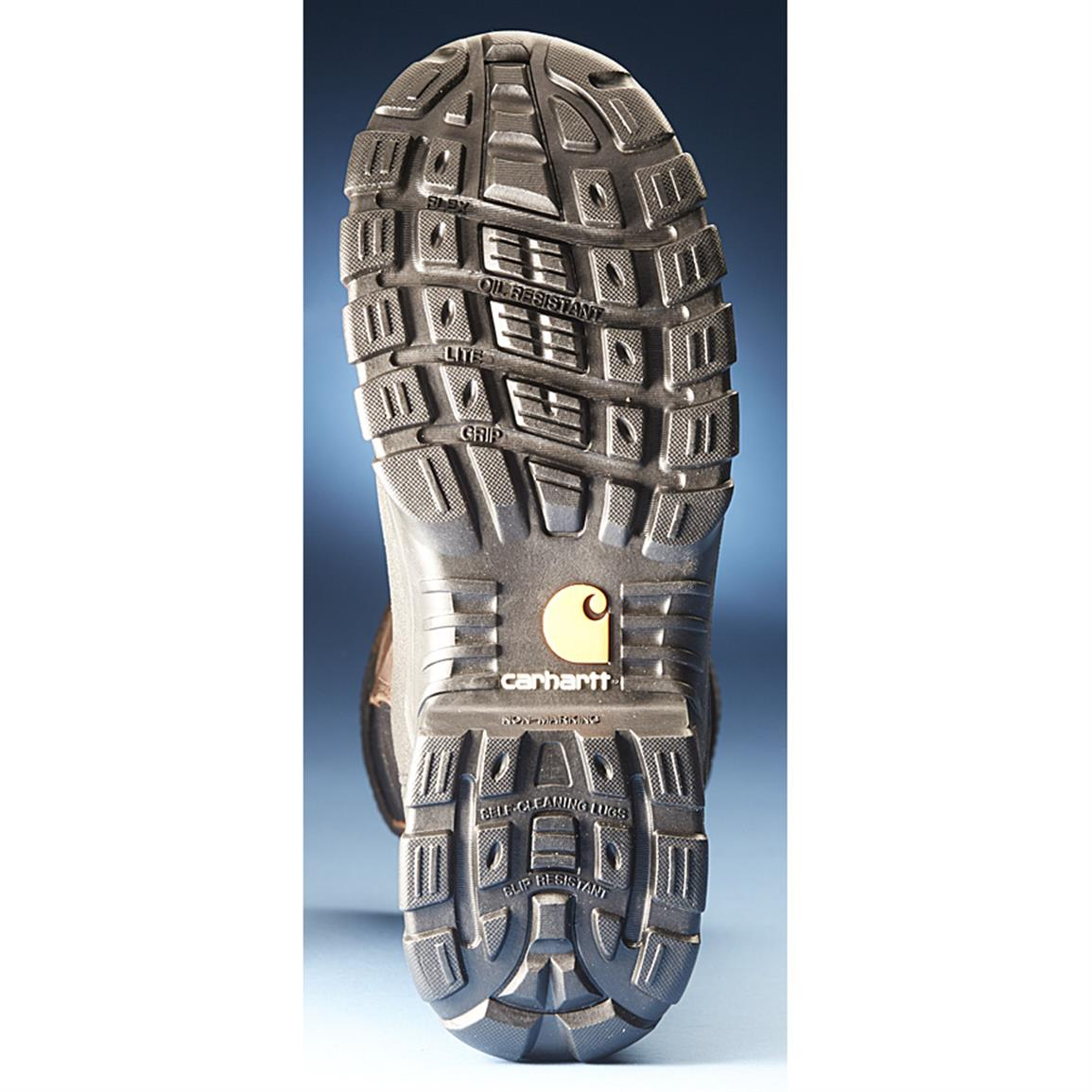 Abrasion-resistant rubber outsole with gripping lugs and ladder lock channels