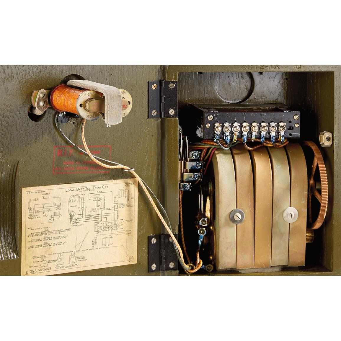 Hinged door reveals internal communication workings and operations diagram from yesteryear