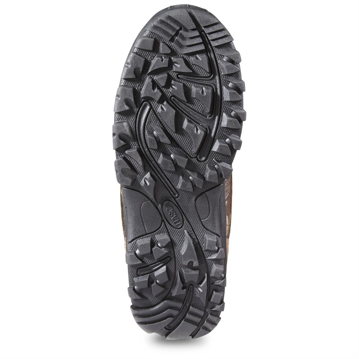 Outsole with heavy tread for ground-biting traction