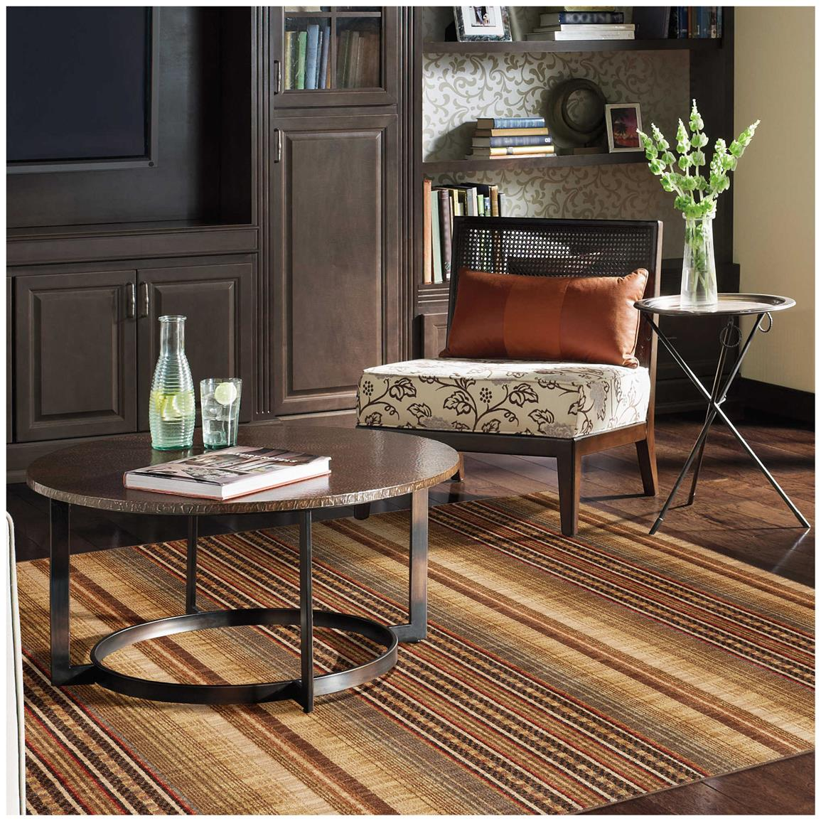 Rustic hues of transitional, horizontal stripes showcase your floor and decor