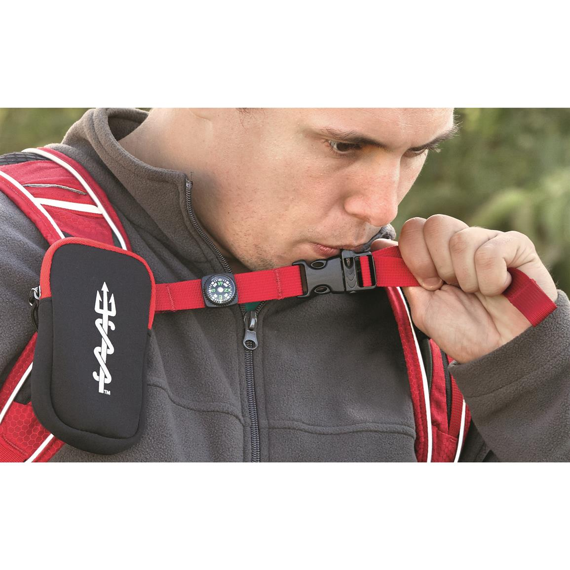 Emergency whistle and compass on chest strap
